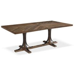 Traditional styling today is a timeless blend of familiar details combined with unexpected elements. Just like this Traditional Iron Trestle Table has with its curved metal base paired with a V-match planked top in the worn and rugged Shop Floor finish. Magnolia Home curated by Joanna Gaines.