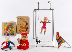 "Lot 469: Japanese Wind-Up Toy Assortment; Four items including a celluloid acrobat, a Peter tumbling jester clown in original box, a ""My Baby"" Santa Claus in original box and a bellows tweeting bird squeeze toy"