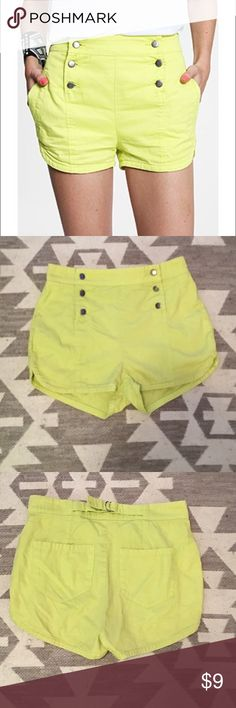 """BDG High Waisted Neon Shorts Neon yellow/green with six buttons in the front, has side pockets and back pockets, 12"""" in length, 15"""" across, adjustable waistband in the back, 100% cotton, size 6. Worn a few times, small rip on one of the sides (shown in photo). Can probably be easily fixed, not very noticeable. No other signs of wear. Happy to answer any additional questions! Urban Outfitters Shorts"""