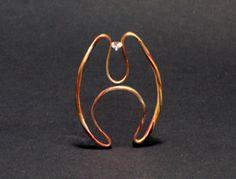 Ring by Arata Fuchi.  Silver, 18k yellow gold, shibuichi, shakudo, zircon