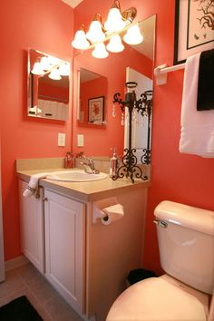 coral powder room - add some turquoise accents