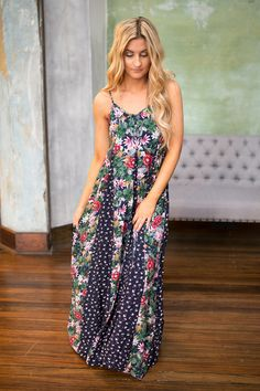 Shop our mixed floral print maxi dress in navy. Pairs perfectly with a fedora and sandals for an effortlessy boho chic look. Free shipping on all US orders!