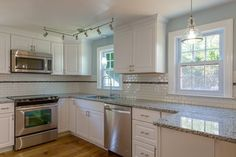Contemporary Kitchen with flush light, Pella Architect Series 850 Single-Hung Window with Traditional Grille Pattern, Flush