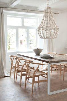 So Nordic looking; LOVE! light-wood floors & Wishbone-chairs, white metal (?) base, white chandelier
