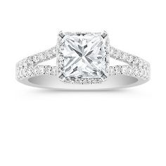 Halo Diamond Engagement Ring with Pave Setting. Shown with diamond center stone. Available with your choice diamond, ruby or sapphire.