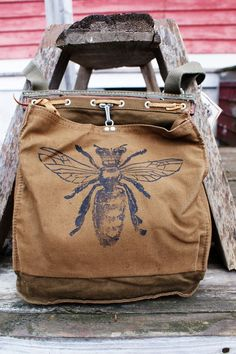 Queen Bees rule the hive. Our original crowned bee image has been screen printed by hand in black ink Vetements Shoes, I Love Bees, Bee Jewelry, Antique Jewelry, Jewellery, Fru Fru, Bee Art, T Shirt Designs, Bee Happy