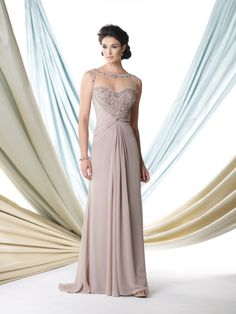 Sleeveless chiffon A-line dress with illusion bateau neckline trimmed with ornate hand-beading, sweetheart bodice encrusted with beading features an unique beaded illusion racer back, midriff and skir