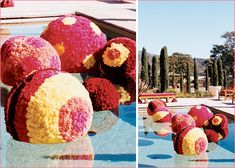 floating styrofoam balls covered with red, fuchsia and yellow carnations made a colorful splash in the pool