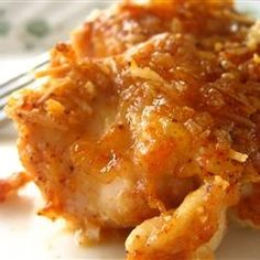 Baked Parmesan Paprika Chicken - so easy to make and turned out so wonderfully! This is a great chicken dish! Very tasty. Next time I am going to add chicken broth instead of butter to cut calories! YUM