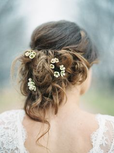 Messy Up Do With Flowers Wedding Hair | Wedding Sparrow
