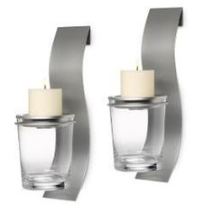 Modern and sleek, our silvertone sconce features a glass vessel for an ever-changing display of your own fillers. Metal candle dish holds a round pillar candle or tealight, all sold separately. Sconce set of 2, each measures: 15 3/4  PARTYLITE.BIZ/LIGHTSWITHLAURA