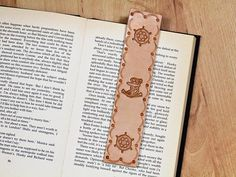 Handmade Bookmark, Leather Bookmark, Nautical Bookmark, Ships Wheel Bookmark. Repin To Remember. #anchor, #anchorbookmark, #shipswheel, #nautical, #nauticalbookmark, #leatherbookmark, #bookmark, #bookmarker, #handmadebookmark, #handmadebookmarker, #leatherbookmarker, #leather, #leatheraccessories, #etsy, #etsyshop, #etsyfinds, #etsygifts, #handmade, #handmadewithlove, #tinasleathercrafts.