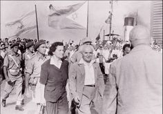 """David Ben-Gurion, Israel's first prime minister, and his wife Paula  celebrate Israel's independence at Haifa harbor. For Ben Gurion, who migrated  to Ottoman-controlled Palestine in 1906, this marked the culmination of a  lifetime of struggle. Israel's declaration of independence, signed on May 14,  1948, asserted that self-determination represents """"the natural right of the  Jewish people to be masters of their own fate."""""""