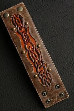 Celtic Sunrise Leather Cuff - Materials: kidskin leather, kangaroo leather copper studs, buffalo leather lining by Chad Little at EthosCustomBrands on Etsy