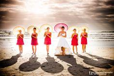 Bridesmaids on the beach with umbrellas