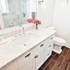4 Men 1 Lady -  simply white, painted vanity, honed carrera marble countertops, porcelain tile, wood look porcelain floor, wood look porcelain tiles, wood tile, Kohler Purist Faucet, Kohler Ladena Sink, Kohler Memoirs Toilet,