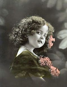 curly-haired girl in green