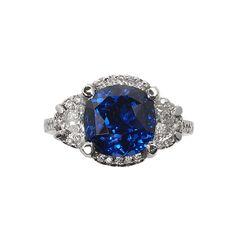 4.20 ct cushion sapphire and hald moon diamond engagement ring