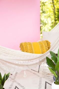 Create this hammock to turn your backyard into a scene from an Anthropologie catalog ;)
