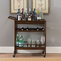 Host your next gathering in style with the Napa Bar Cart. Beautifully designed with sleek lines and dark wood, this wheeled cart is mobile to go where the party is, holds up to 6 wine bottles, and has ample storage for liqueurs, glasses and mixers.