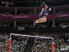 Britain's gymnast Elizabeth Tweddle performs on the uneven bars during the artistic gymnastics women's apparatus finals.