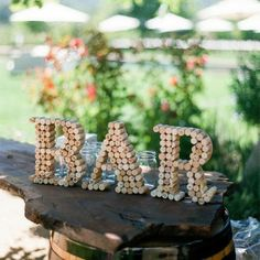 Having a sign for the bar at your wedding? You could try a DIY bar sign made of corkscrews!
