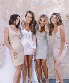 Love the neutral shades that the bridesmaids are wearing! Photo by Lara Hotz.