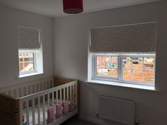 This really cute nursery was finished off with Blackout Deluxe Roman Blinds with Pink, Purple and Grey stars