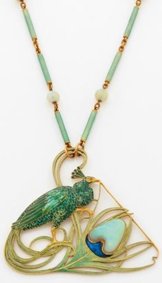 An Art Nouveau pendant-necklace, by René Lalique, circa 1900. Originally probably a hair ornament, the pendant designed as a peacock, a symbol of immortality, decorated with iridescent enamel, the end of the feather set with a cabochon opal, mounted in gold, suspended from a chain composed of gold, enamel and opal beads. Signed. #Lalique #ArtNouveau #pendant