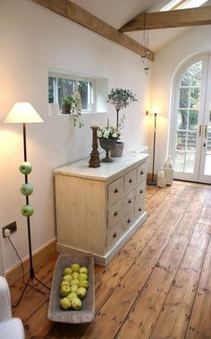 Love these wide pine plank floors + exposed beams with plaster walls in The Swenglish Home