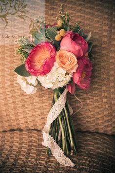 Unstructured natural stem posy of coral peonies, columbian roses, craspedia, lambs ear foliage, hydrangea, solid aster and yellow billy buttons. Tied with vintage crochered lace www.jademcintoshflowers.com.au