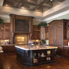 I love this huge kitchen & definitely the dark colors!!