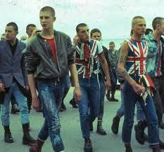 The skinhead subculture emerged in the UK in the 1960's. It came from an earlier subculture, the Mods. It was originally associated with black popular music like soul, reggae and ska. Skinheads are usually part of the working class and are mainly young men. Skinheads are recognizable by their shaved head and usually wear Doc Martens or army surplus boots, jeans, polo shirts and bomber jackets but skinhead fashion is diverse. Nazi skins, or white power skinheads also appeared (see Paki…