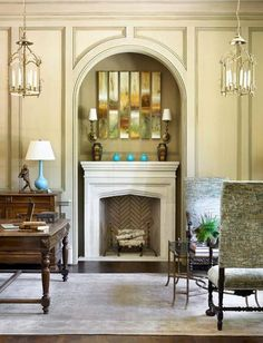 Neutral Greens with Bursts of Blue..Quartersawn oak paneling with a whitewashed finish enhance the autumnal vibrancy of the green and gold artwork above the limestone fireplace. Touches of turquoise punctuate the cool palette  Traditional Home