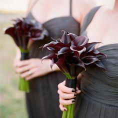 Dark Purple Calla Lilly Bouquets against dark dress.....