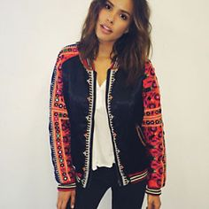 New Romantics Embellished Baseball Jacket   Silky baseball jacket with eye-catching embroidery and decorative mirror accents throughout. One side can be reversed for a more casual, laidback style. Side pockets on both sides. Zip closure. Sporty ribbed waist, cuffs, and collar. Cute