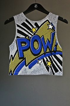 (£7.00) This is an all time classic POP ART crop top with 'POW' comic cartoon letters. Very trendy and can be purchased with matching style necklaces. Different kinds to choose from. 85% Polyester+15% Cotton. Brand new with tags