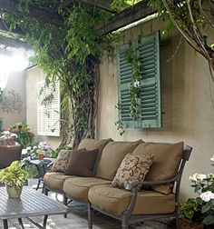 Love the hanging of shutters... so going to do this to hide an electrical box on my deck/patio