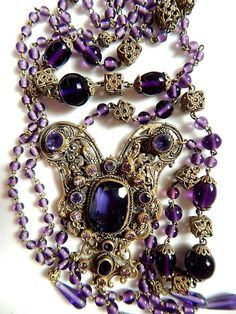 Max Neiger, Czech, Amethyst Glass, Filigree, Flapper Necklace.  Vintage item from the 1920s. Gorgeous filigree work and lovely purple glass stones and beads. The pendant is like a composition of the crescent moon shapes and has three separate crescent moon filigree back plates....