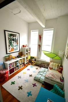 Sophia's White, Bright & Magically Modern Bedroom: KIDS ROOM TOUR. I like how the ikea bookcases are set up and like the Ikea leaf canopy over the bed. I like the set