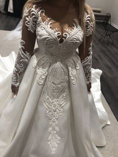 You can have this plus size long sheer sleeve wedding dress with ball gown over skirt made in any measurements. We are US dress makers who specialize in custom #weddingdresses for fuller figured brides. We can also make a #replica of any couture dress you love that will look like the original but cost way less. Email us for pricing on custom plus size wedding dresses and inspired designs. #weddinggowns #Plussizeweddingdresses
