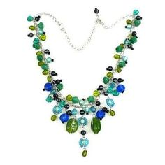 Green and Blue Glass Bead Charm Necklace - Fair Trade - #fairtrade #shopfairtrade #thisbluesea  This flashy bead necklace features a mixture of smooth and faceted blue and green glass beads. The necklace measures 17 inches, plus a 2 inch extender, on a silver-toned brass chain.  Meet the Artisans  Metal Artisan in Haiti  WorldFinds is a member of the Fair Trade Federation. They regularly travel to connect with our artisan groups in India, Indonesia, and Nepal, and each time it is evident how…