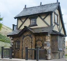 A custom storybook playhouse.  Do they come in adult sizes too?  Next time you have an extra $8000 you don't know what to do with...
