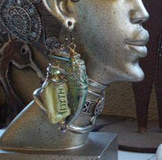 polymer clay myth and dragon tooth asymmetrical earrings