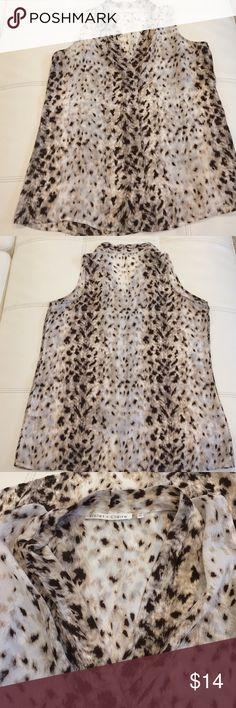 Like new Violet+Claire sleeveless blouse Violet + Claire sleeveless animal print blouse. Very soft 100% polyester. Like new Violet & Claire Tops