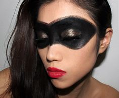 Superhero makeup with black eye mask and red lips