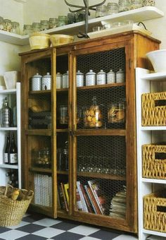 Pantry ideas...love the floor, baskets and cabinet