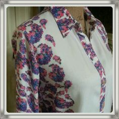 Stop and smell the roses white floral shirt Step into spring with this beautiful white and floral patterned button up shirt. Gorgeous cond. Worn only once. Sleeves can be buttoned up or down. Rayon ronson Tops