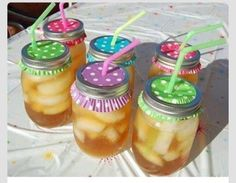 Use cupcake wrappers to cover your mason jar ...use your straw to poke a hole through, unwelcome critters stay out.