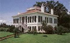 Weymouth Hall is a grand Greek Revival house which sits atop one of Natchez' highest bluffs, rising high over the river. The panorama of river, Louisiana farmland, and forest that stretches out before you is, in a word, breath-taking.  The Natchez City Cemetery, lies just across the street.